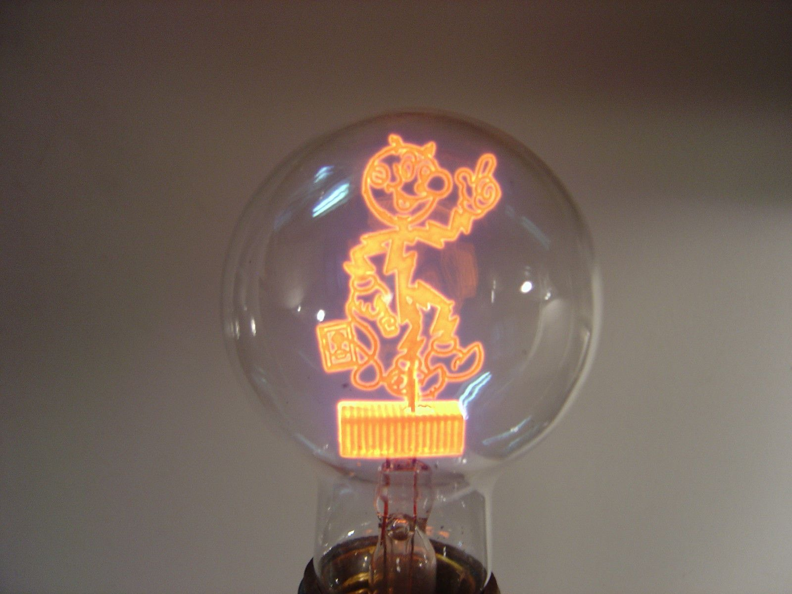 Captivating RARE Aerolux Reddy Kilowatt Figural Neon Filament Light Bulb (1940u0027s)