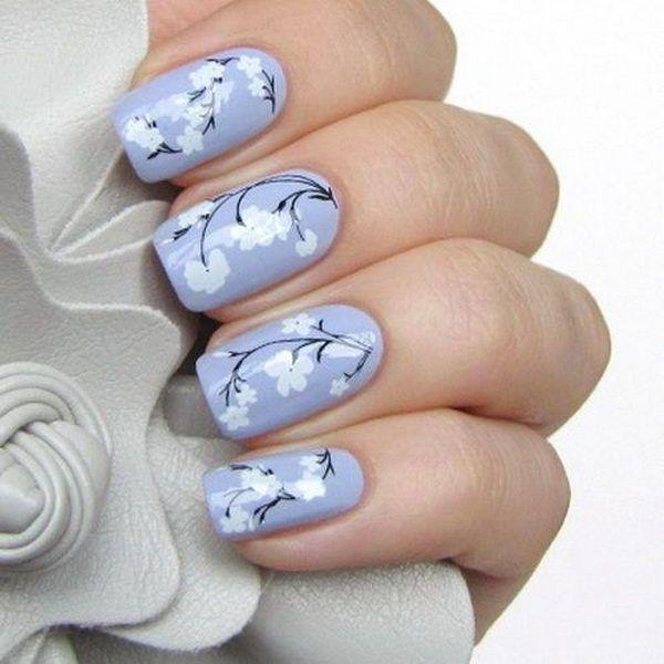 Pretty flower nail art these flower designs are so cute and make a pretty flower nail art these flower designs are so cute and make a regular manicure look like a piece of artwork mightylinksfo