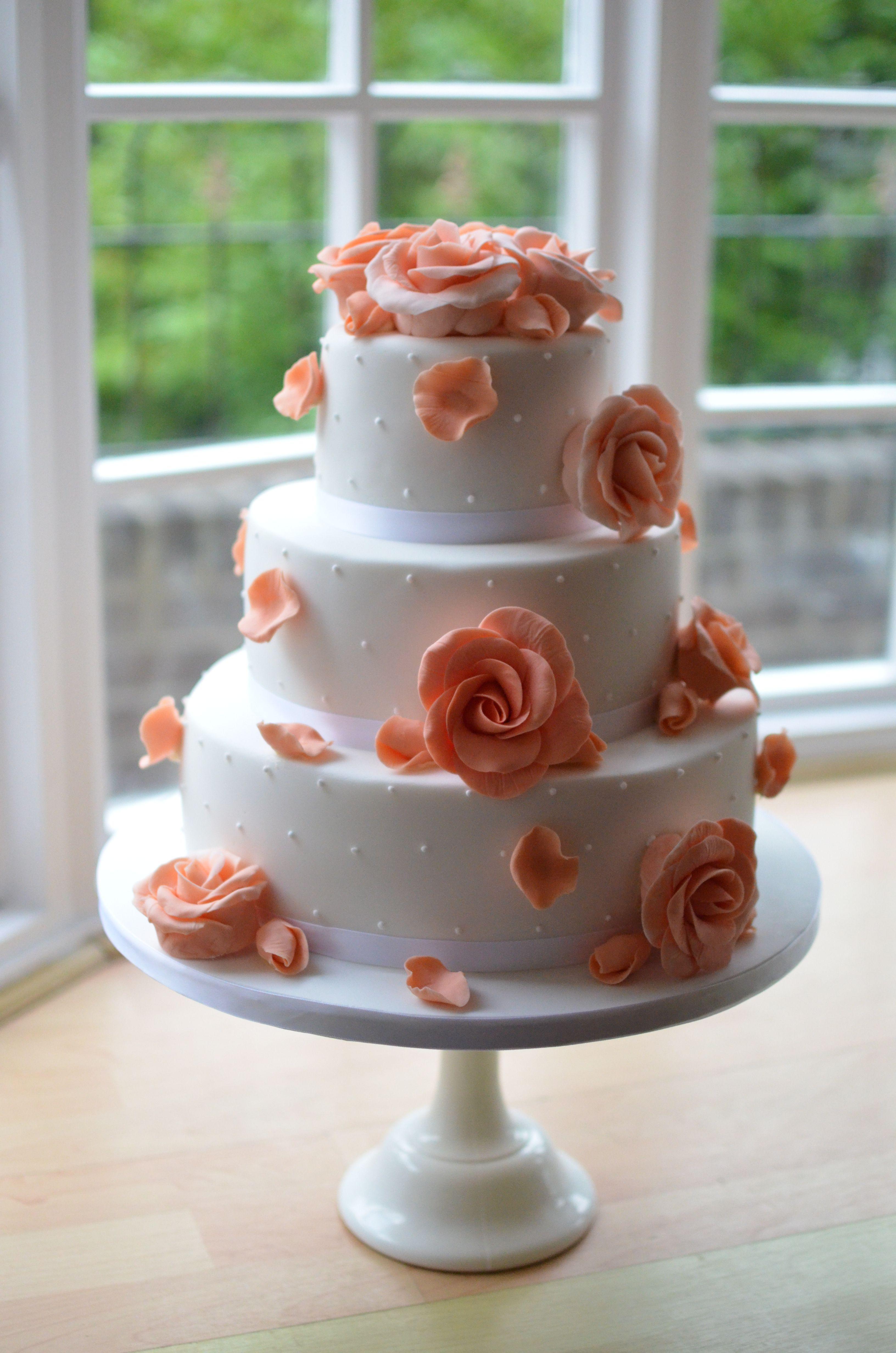 Coral roses wedding cake
