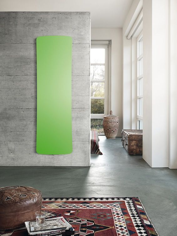 What a fantastic shade of green! This radiator really stands out against the grey wall...