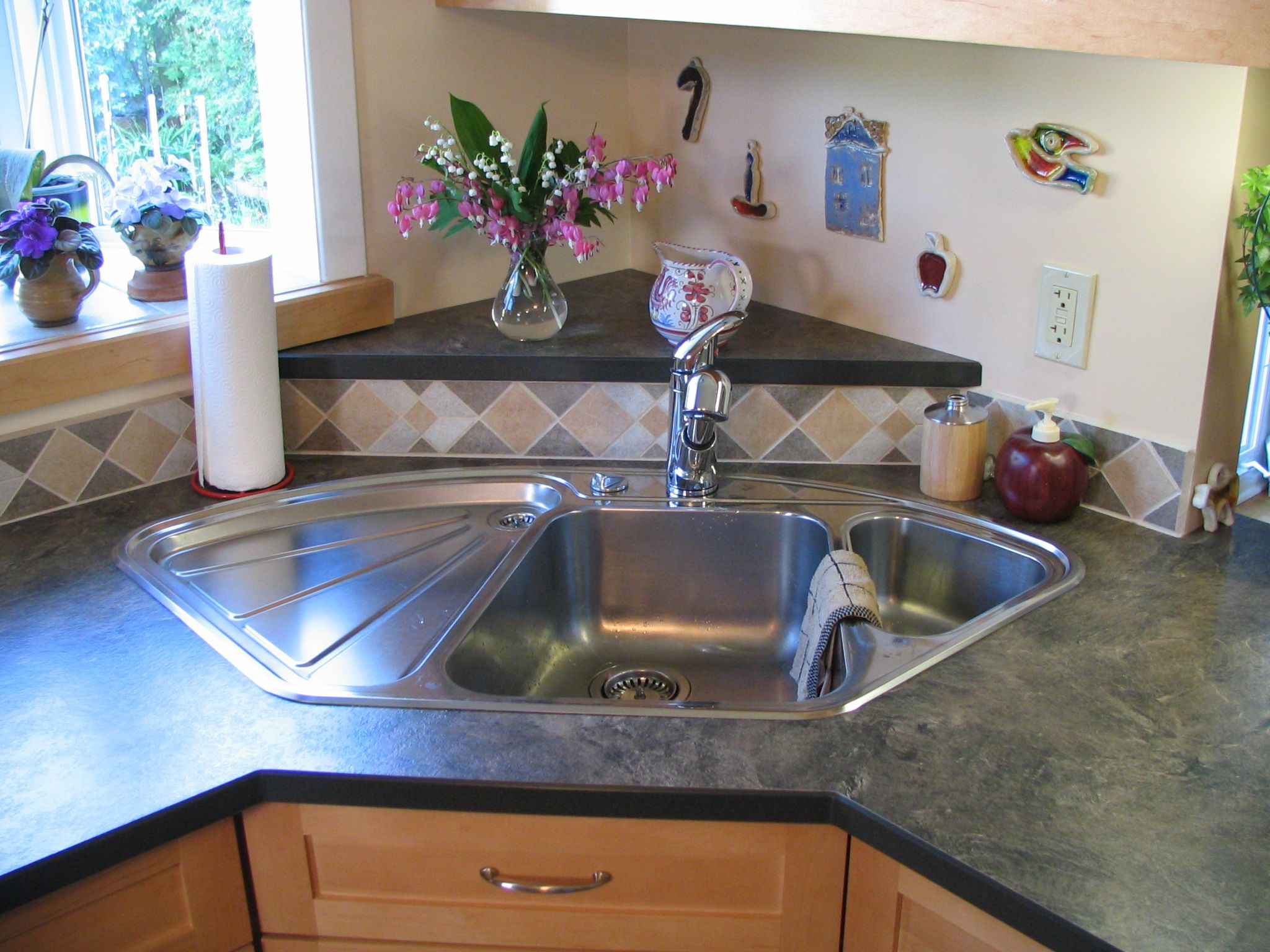 Blanco Corner Sink With Raised Back Triangle Laminate Countertops With Corian Edge Cabinet