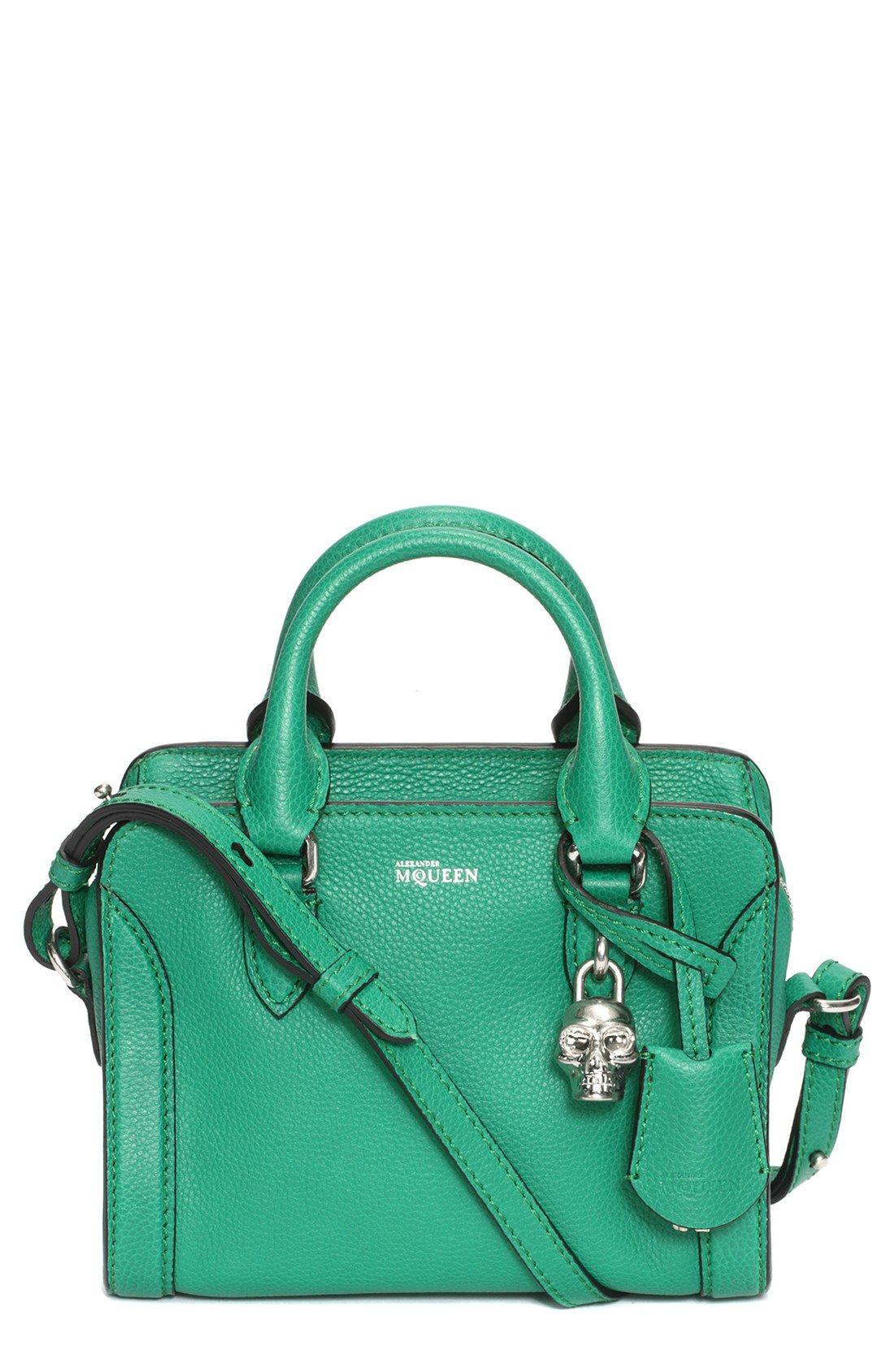 Chic emerald green Alexander McQueen duffel bag with a