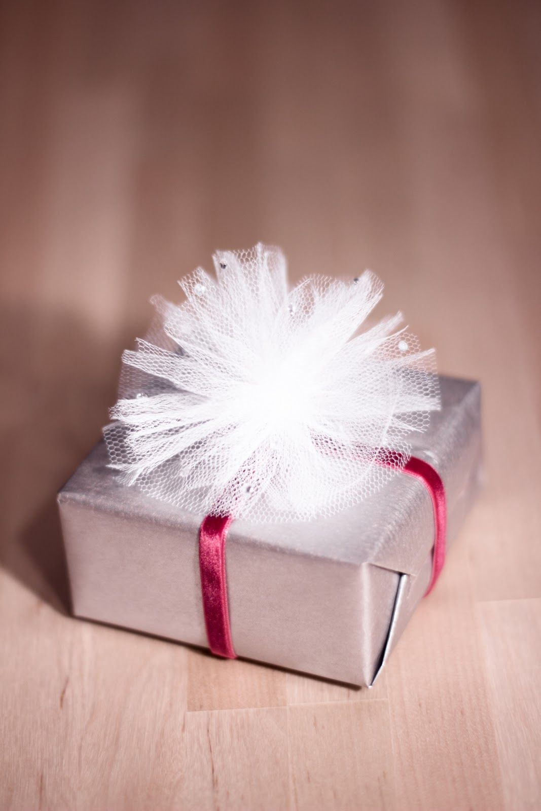Tulle bow this would be an awesome way to wrap presents im not