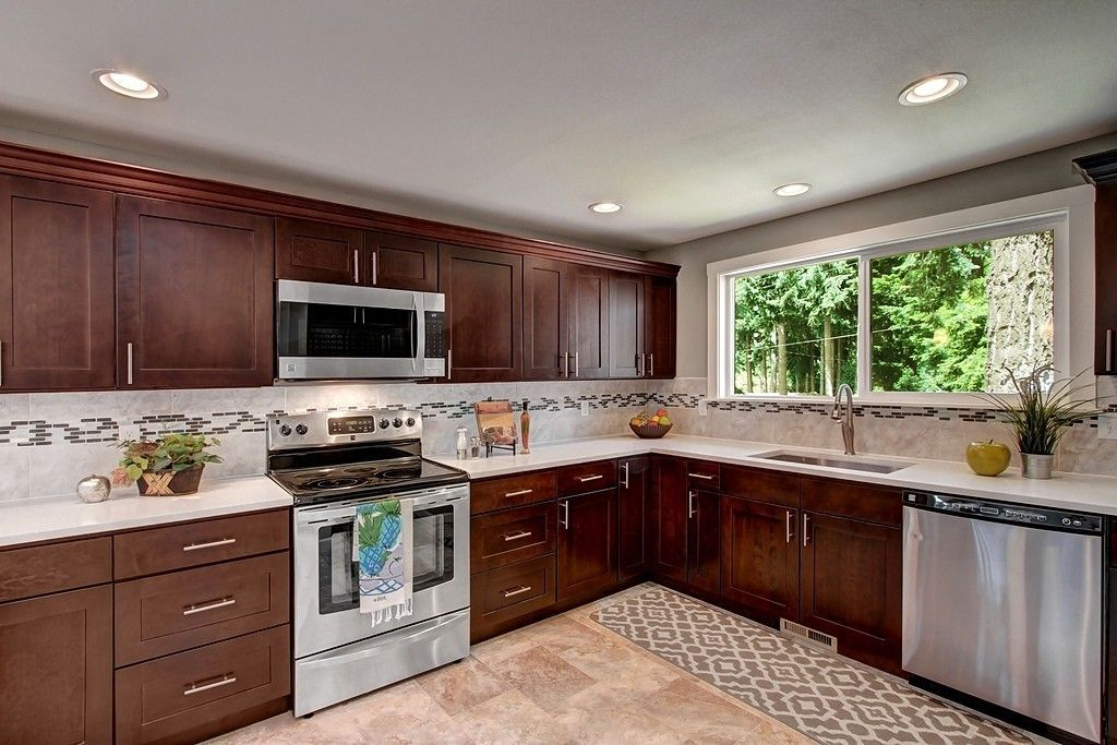 Contemporary Kitchen with Corian counters, European
