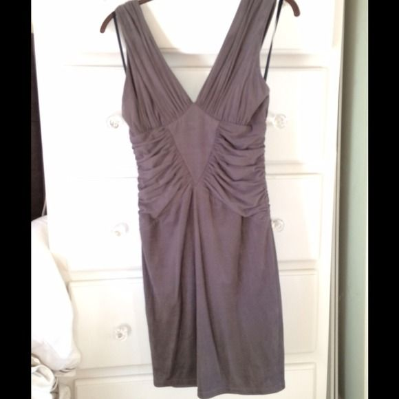 Grey Dress suede-like material Perfect gray dress in v neckline, flattering fit and perfect for date night or night out. Back zip. Worn maybe 2xs. Beautiful dress doesn't fit me anymore bebe Dresses