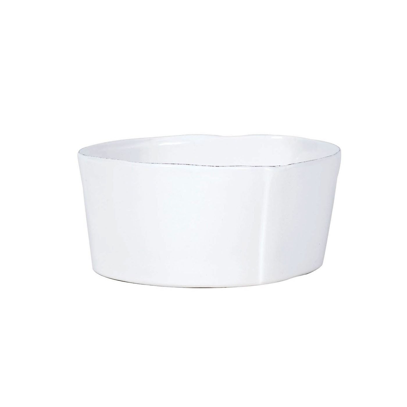 The organic shape of the Lastra White Cereal Bowl is modeled off of the straps that were used to form Parmesan cheese in Italy for centuries.