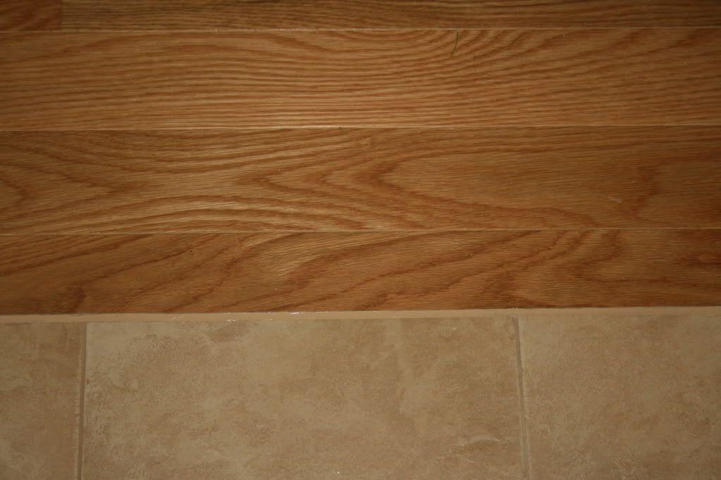 Porcelain tile floor next to hardwood floor used for Wood floor next to tile