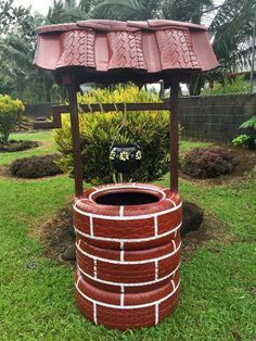 Wishing well planter made from recycled tires -