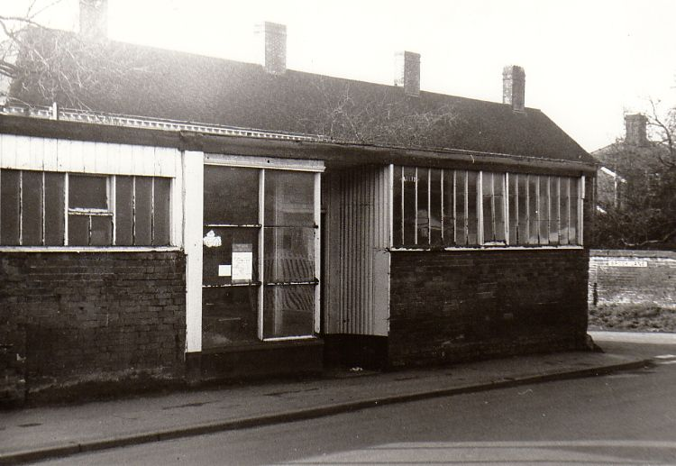A G Potter started out as a basket maker in Framlingham in 1898. By 1901, he had moved to Tomb House and built this cycle shop on the corner of Brook Lane. The photo dates from the early 1970s when it was no longer in use. It was eventually demolished and the junction widened.