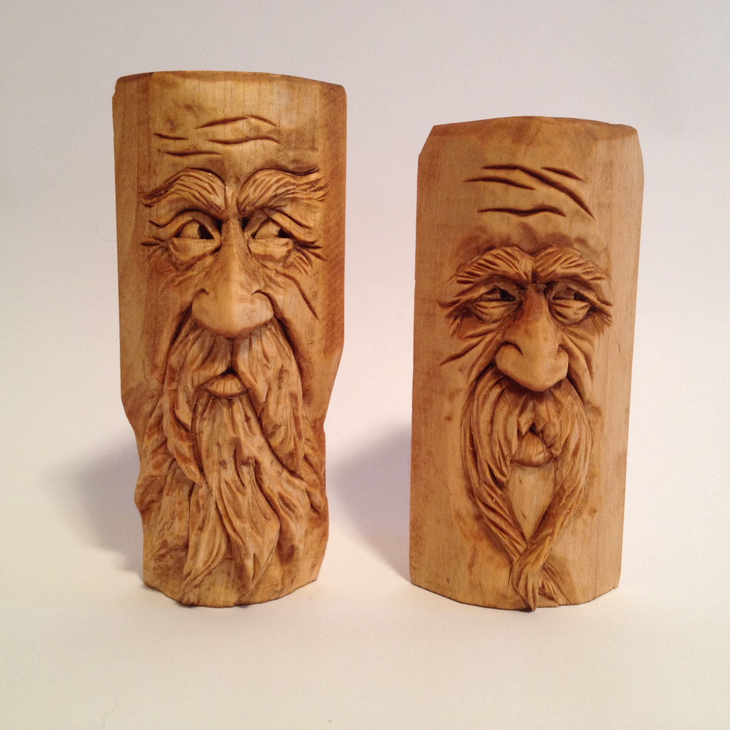 Wood spirits carved by scott longpre l om ad busc
