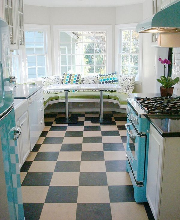 Kitchens That Spice Up Your Home Diner style kitchen with trendy breakfast nook. Retro kitchen. Built in bench. Colorful appliances.Diner style kitchen with trendy breakfast nook. Retro kitchen. Built in bench. Colorful appliances.