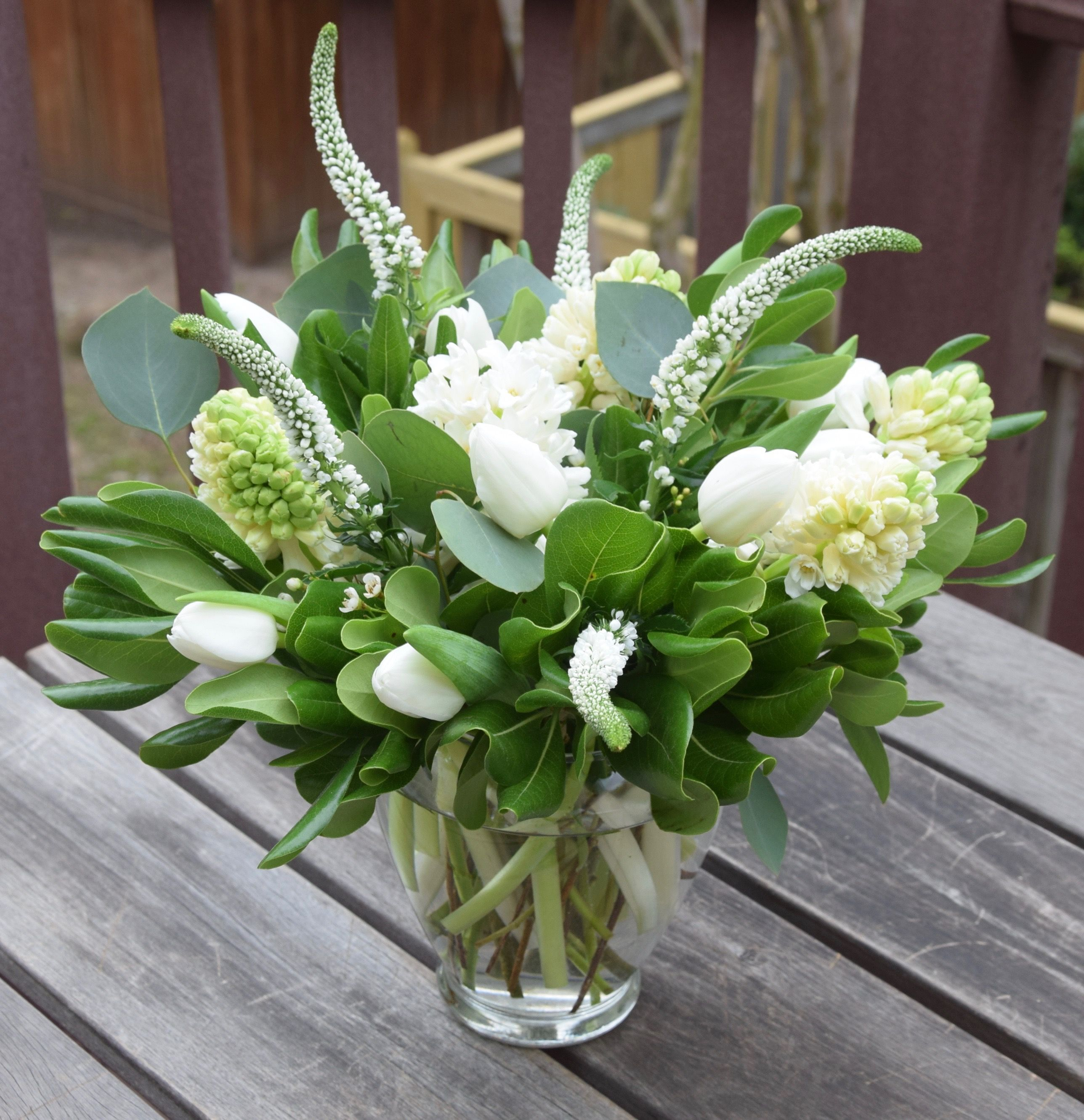 Flower Arrangement In A Vase With White Tulips Hyacinths Veronica And Greens White Flower Arrangements Memorial Flowers Tulips Arrangement