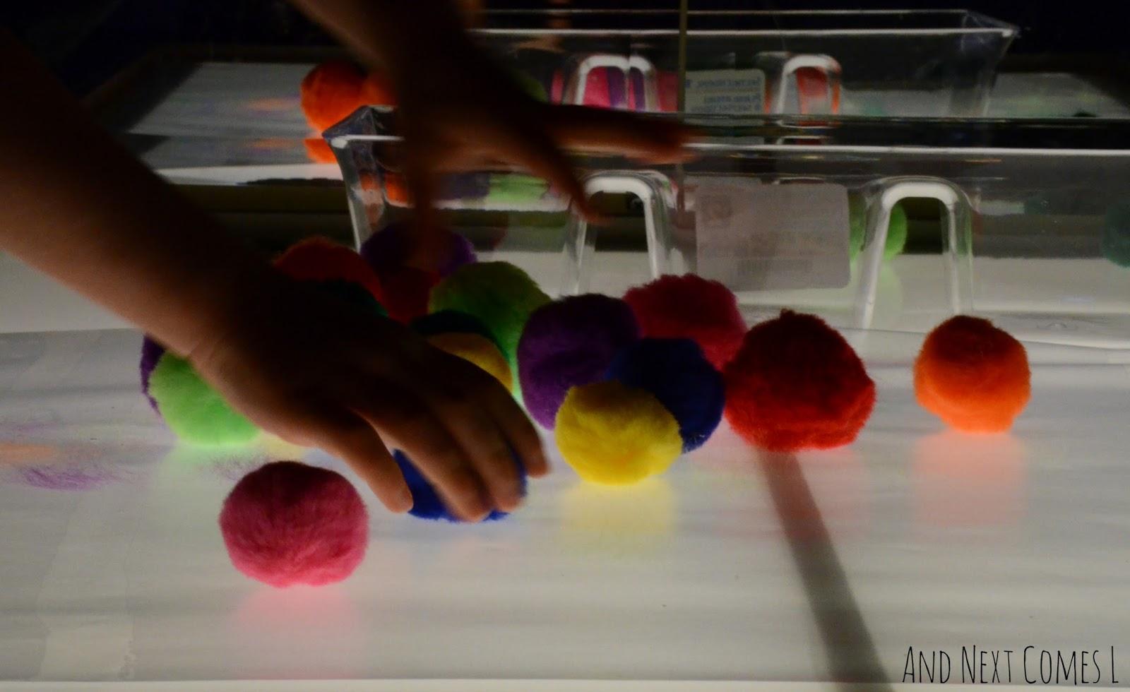 Sticky Pom Pom Art On The Light Table