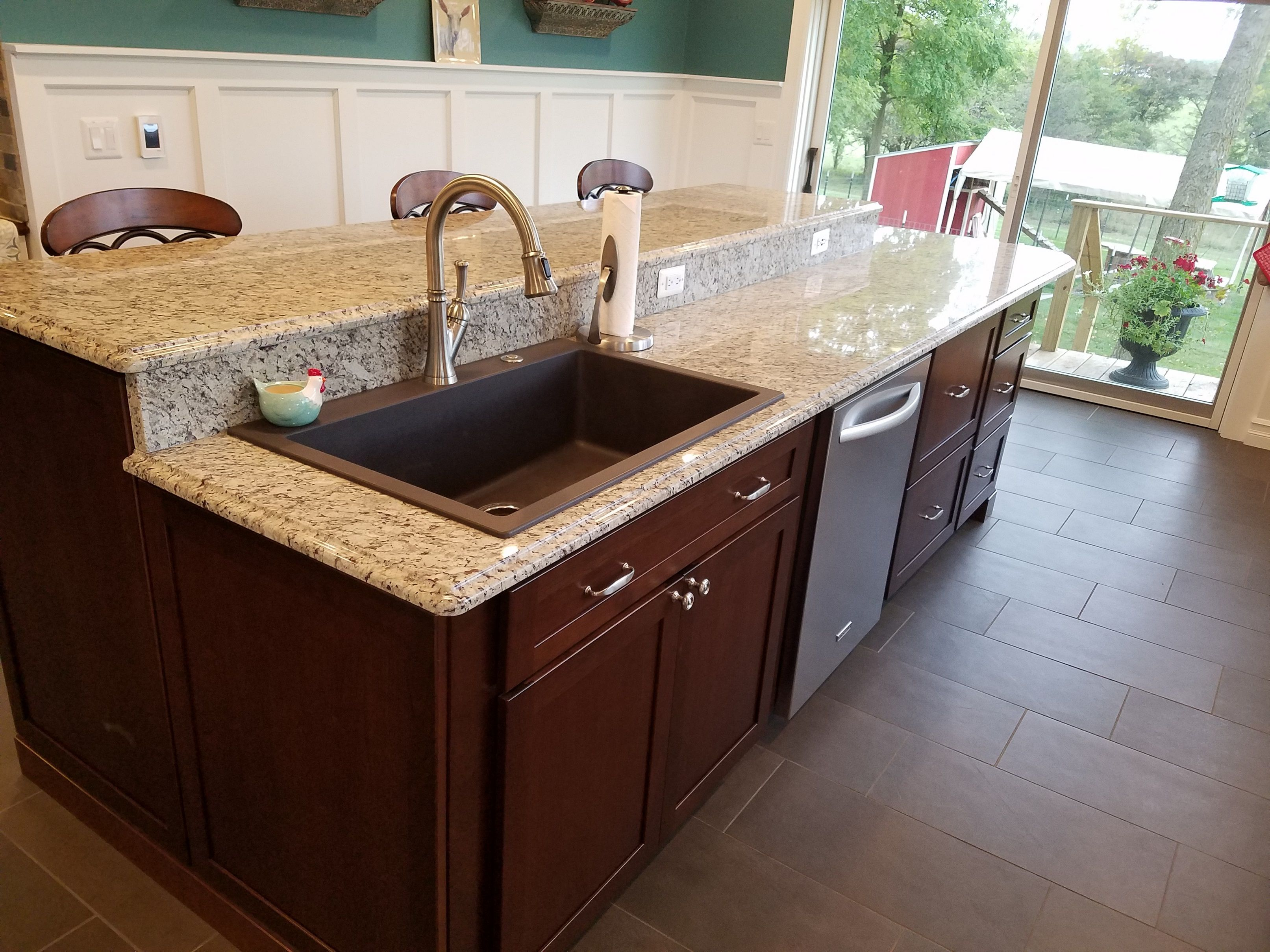 Large, Deep Granite Composite Sink In Graphite Color. White Wainscot  Panelling Was Added To