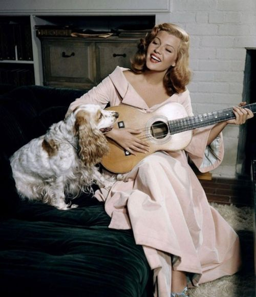 Hayworth. Playing guitar. For a dog.  very silly.