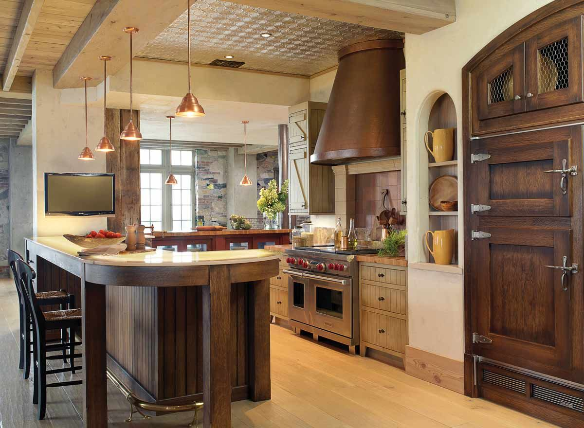 A Farmhouse Style Kitchen With Wood Cabinets An Onyx Counter Copper Vent Hood And