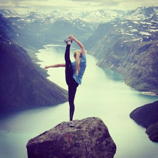 coolest picture ever!! the mountains and her flexibility!!