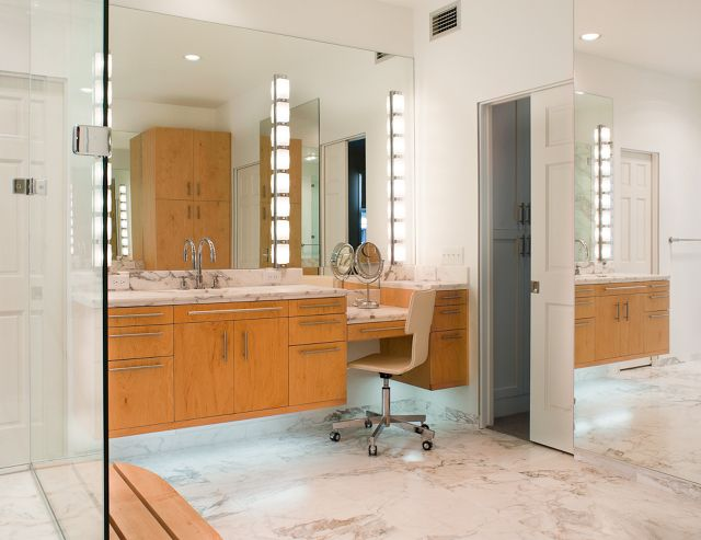 Calacatta marble floors and countertops, Floating maple cabinets