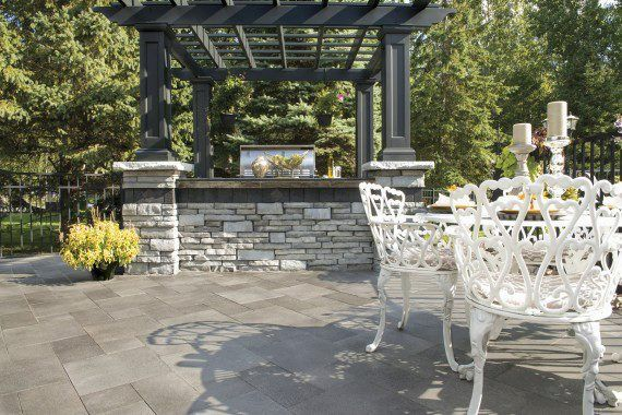 Outdoor Patio With Umbriano Pavers And Rivercrest Wall Grill Island