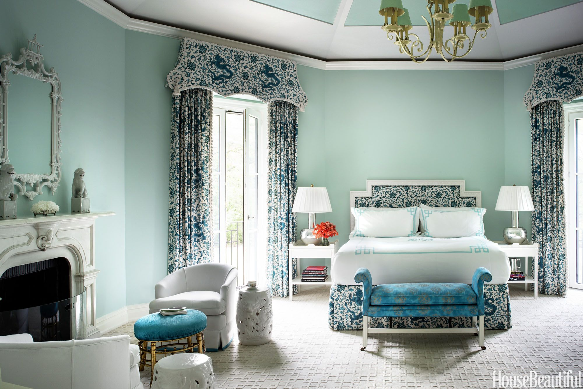 """""""Aqua is elegant and flattering. You feel pretty in this bedroom, and pretty never goes out of style."""" In the master bedroom, Tiffany blue walls — Benjamin Moore's Blue Bonnet — are a cool counterpoint to the deeper hues in the fabrics, from Scalamandré's Chi'en Dragon for the bed and curtains to Osborne & Little's Limpopo on the stool. Vintage swivel chairs are covered in Kravet's Soleil.    - HouseBeautiful.com"""
