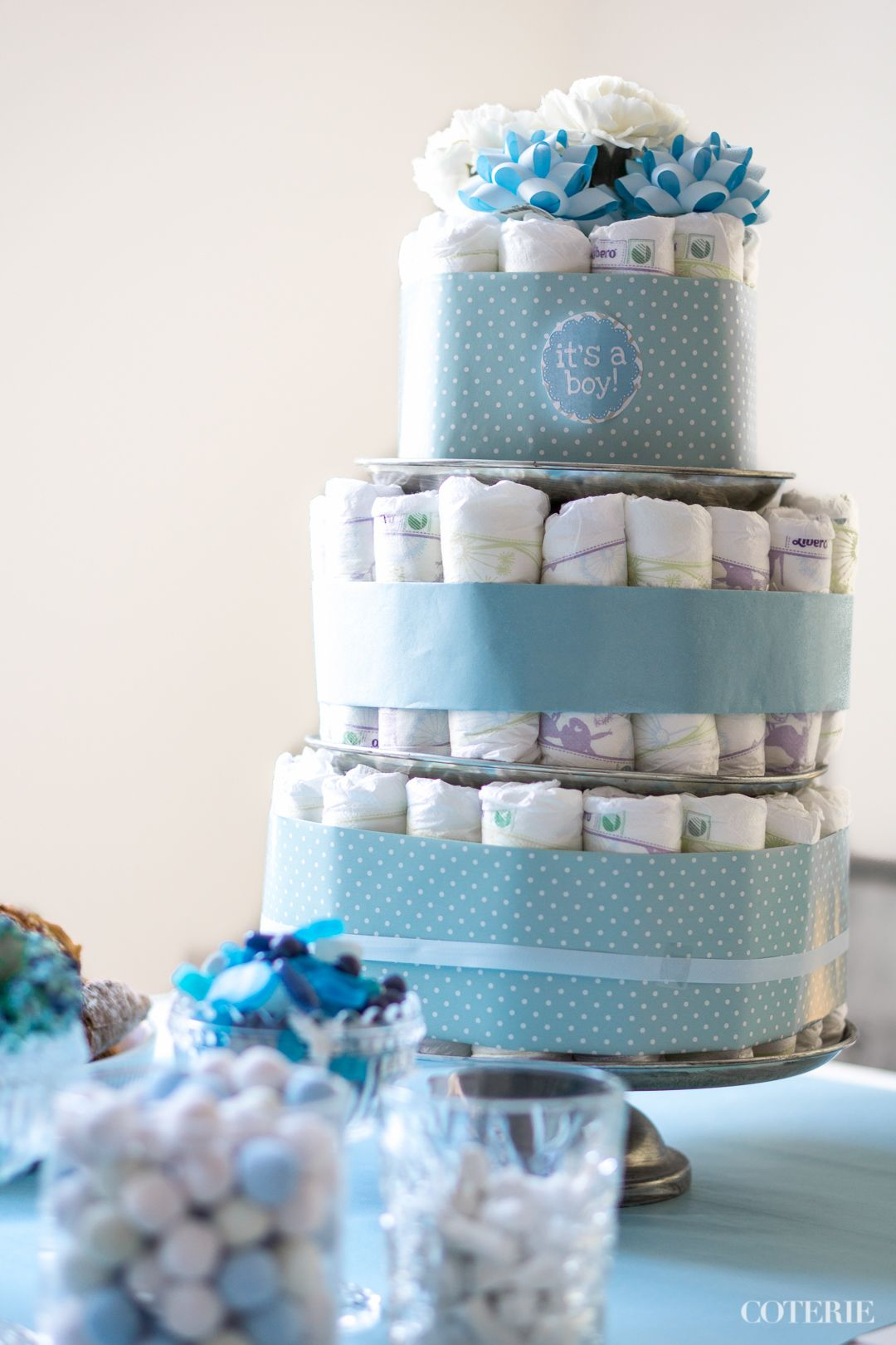 It's a boy! Decoration ideas for a baby shower.  A classic diaper cake was the centerpiece of the table. <3  Check out the whole blog post here: http://www.coterie.fi/baby-shower-for-a-boy-vauvakutsut-pojalle/