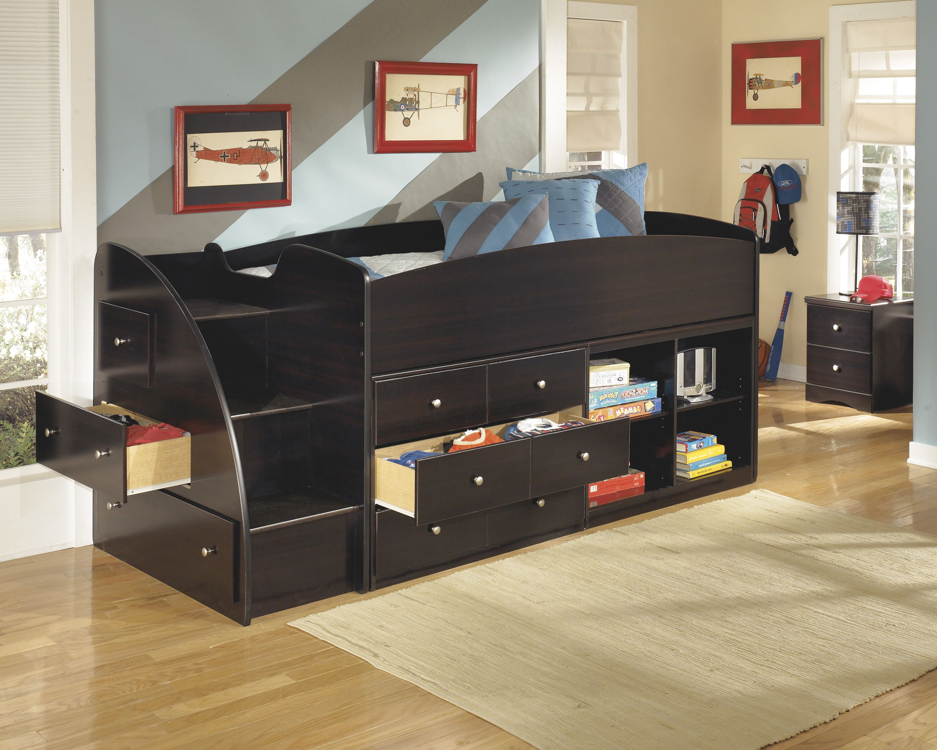 Boys' twin loft bed with storage steps  The dark finish and simplified contemporary design of the