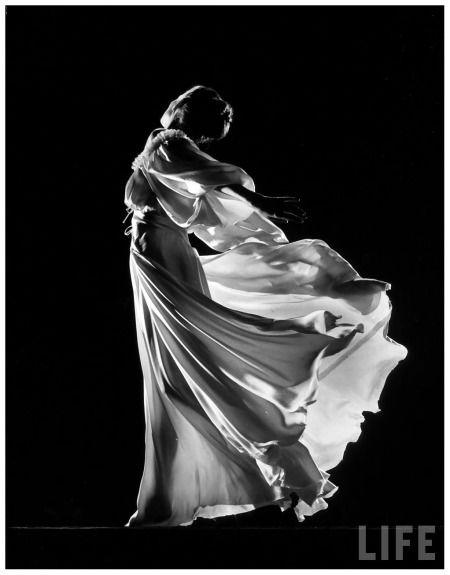 Model posing in billowing light colored sheer nightgown & peignoir Gjon Mili 1945