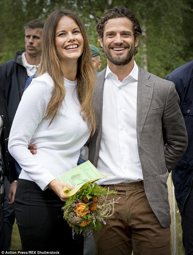 Rain didn't stop play for Sweden's Princess Sofia and Prince Carl Philip as they visited a...