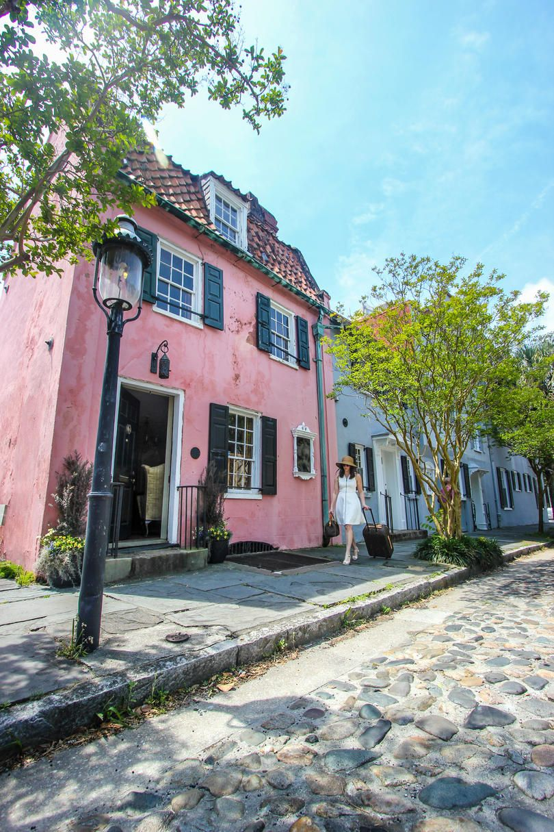 Charleston S Oldest And Most Charming House Is On The Market And We Re Taking You Inside Charming House Pink Houses Charleston Homes