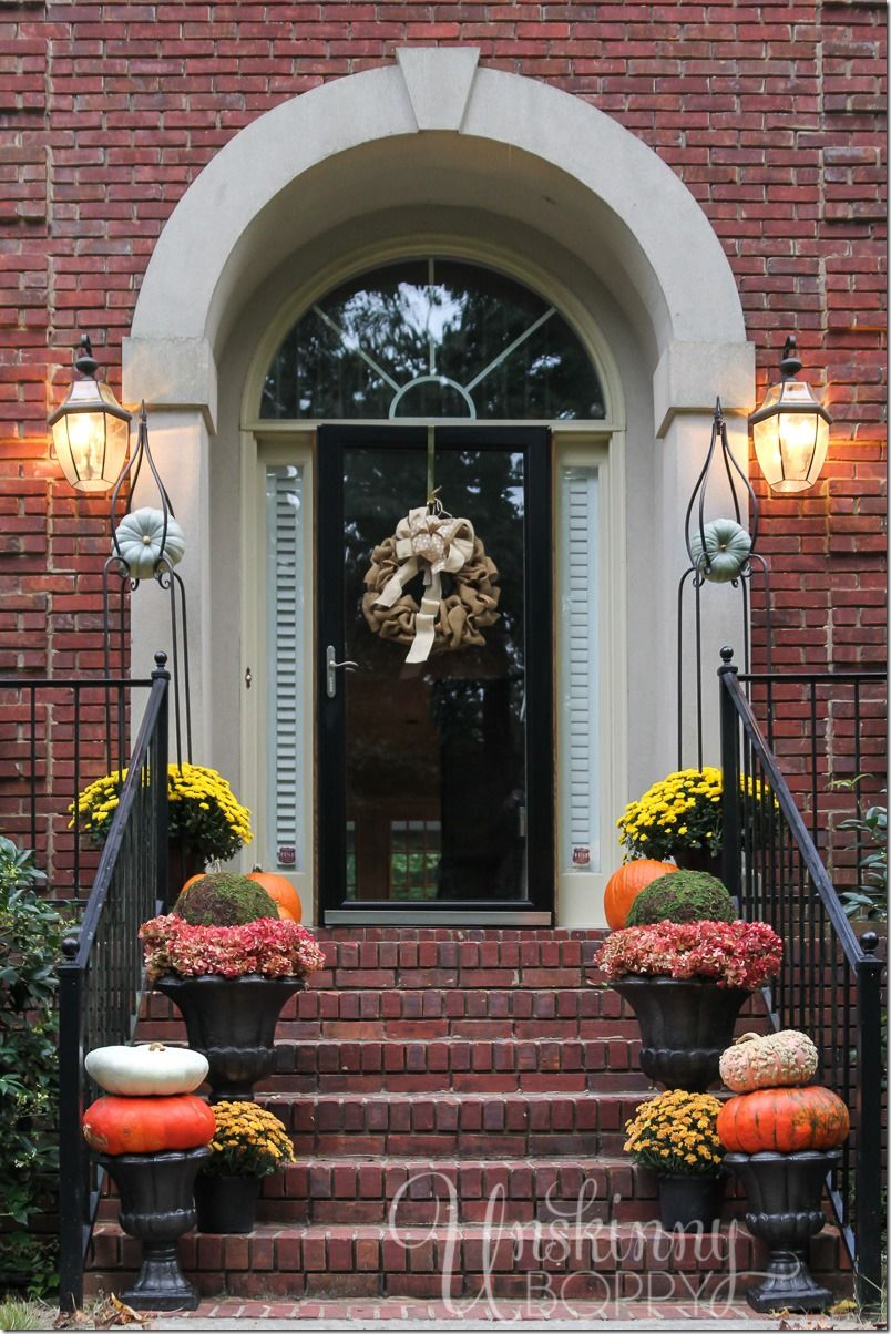 Front porch decorating ideas for the fall- mums, urns, moss balls ...