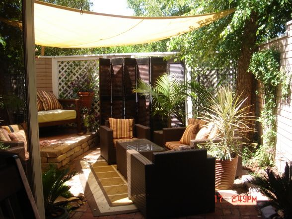 small patio oasis, the cover is a poly-plastic type cover that is ... - Small Patio Shade Ideas