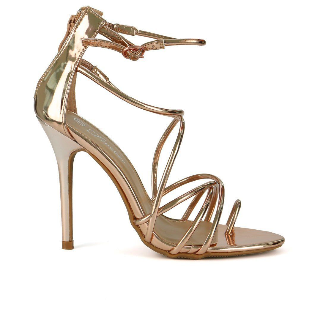e460943ee64 These divine single sole sandals feature trendy rose gold metallic patent