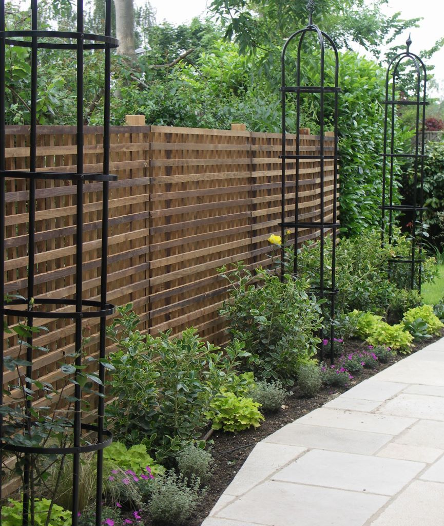 Lattice trellis with rose obelisks and underplanting | Garden ideas ...