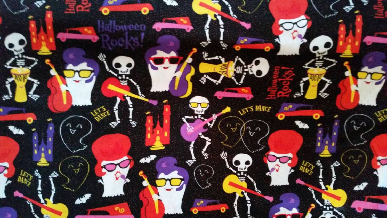Halloween fabric with Elvis ghosts skeleton music glitter