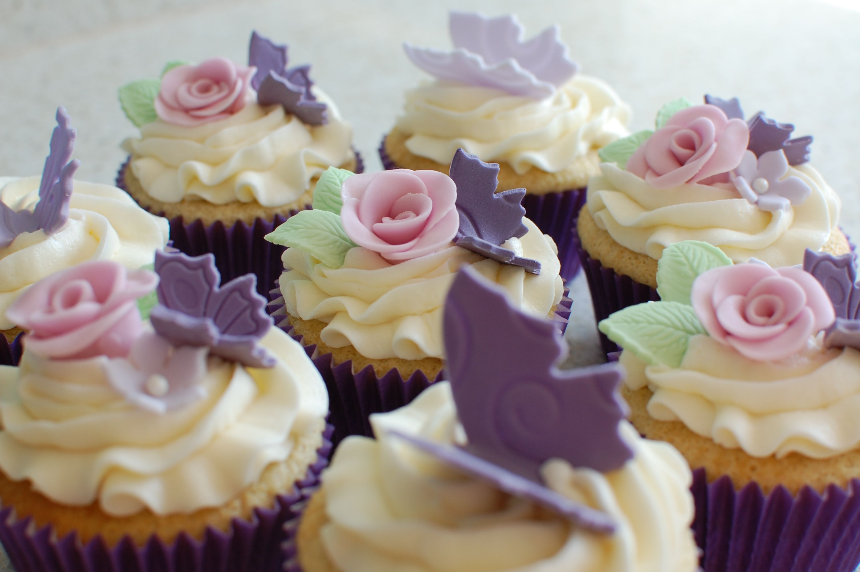 Simple fondant rose flowers & butterfly cupcakes.    Made for my children's school bake sale.