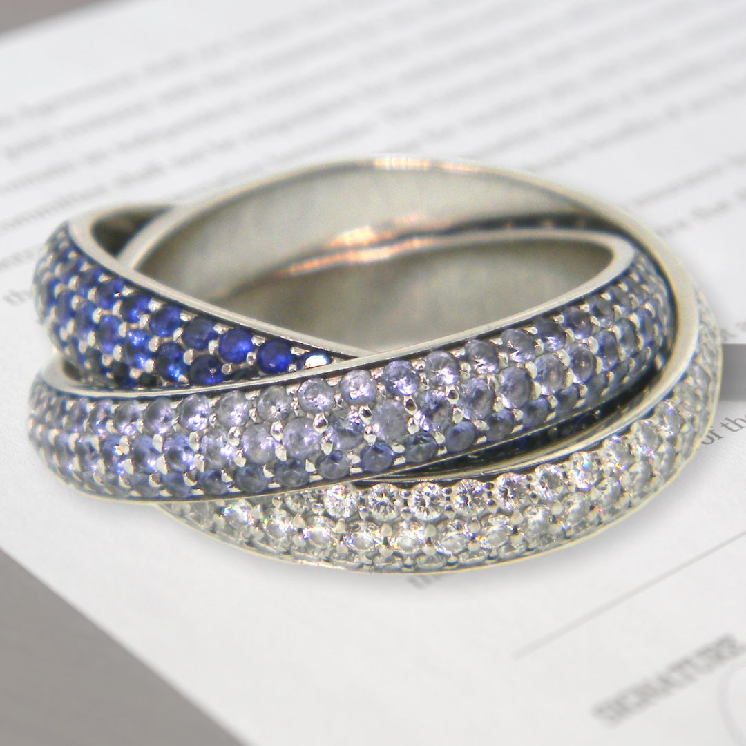 Cartier Rolling Ring with Diamond and Sapphires. Stunning