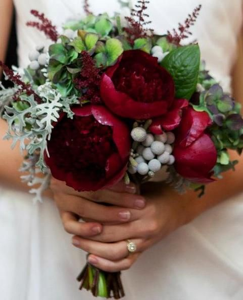 Bouquet using wine colored peonies, hydrangea, dusty miller and privet berry.