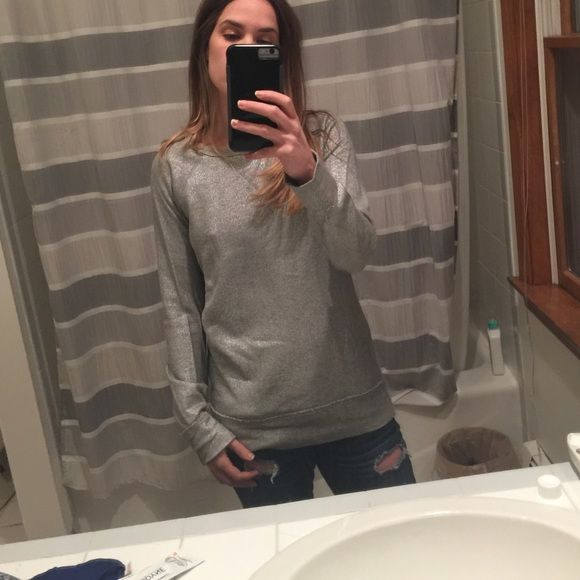 J. Crew Factory Silver sweatshirt Kind of a matte silver sweatshirt. Hits a little lower than the hip, great for leggings and skinnies. Intentional raw edging on the stitching shown. J. Crew Tops Sweatshirts & Hoodies