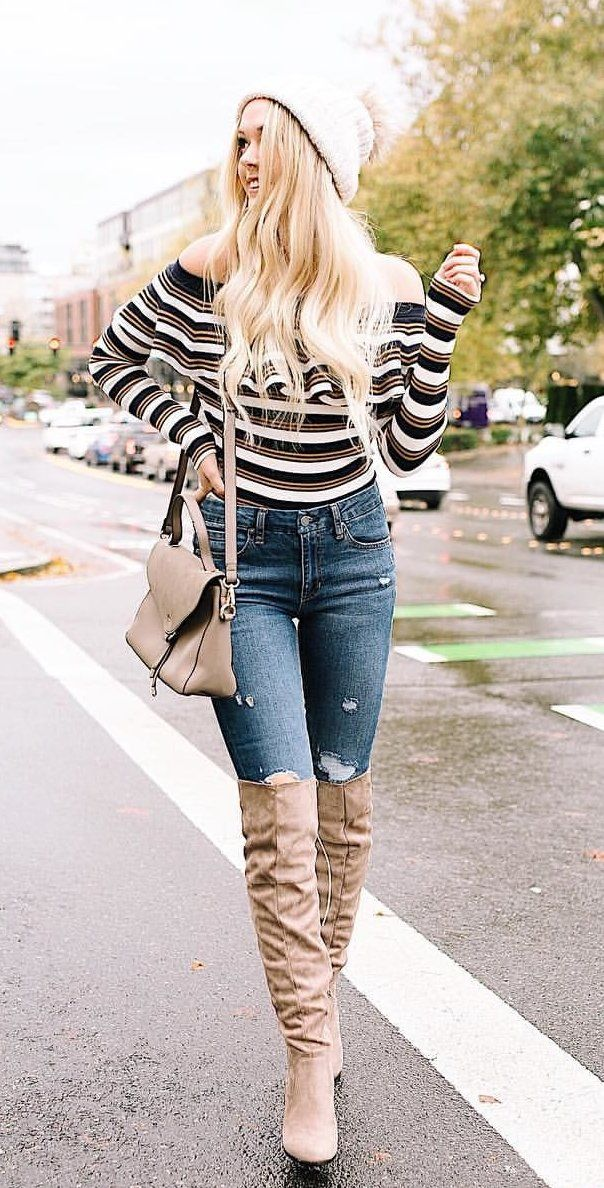 #winter #outfits women's white, black, and red stripe off-shoulder long sleeved top and blue jeans. Click To Shop This Look.