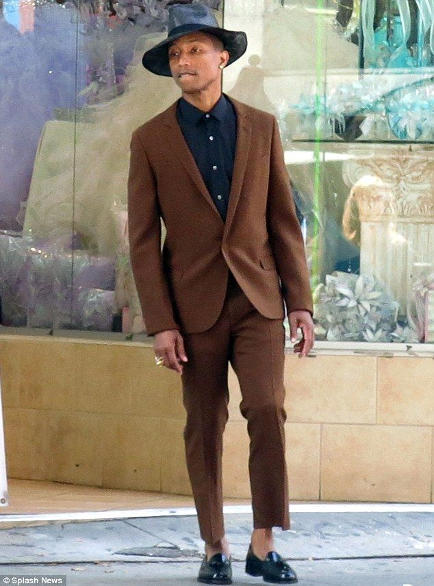 Cool hat: Pharrell Williams wore a brown suit with a funky black ...