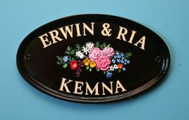 """Oval 12"""" x 7"""" house sign in black with gold letters and hand painted garland motif.   Sent to the Netherlands.  www.rockartisansigns.co.uk"""