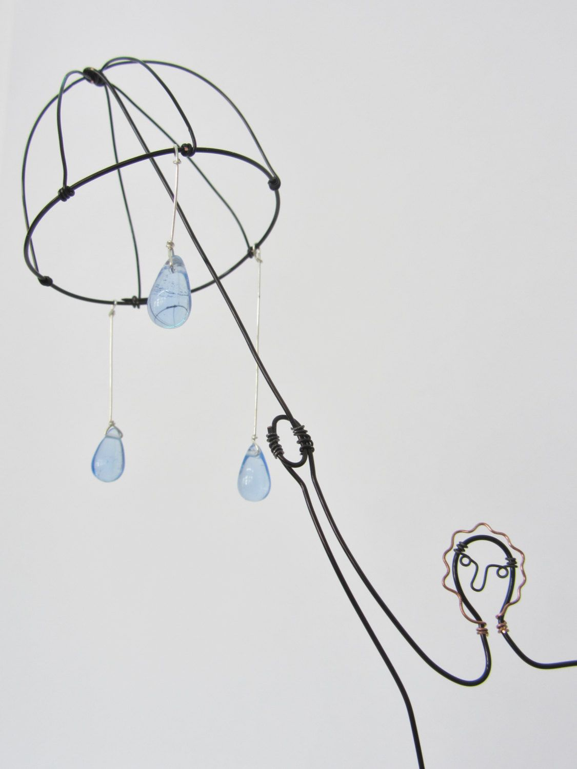 Raindrops and umbrella man small wire sculpture wire for Unusual quirky gifts
