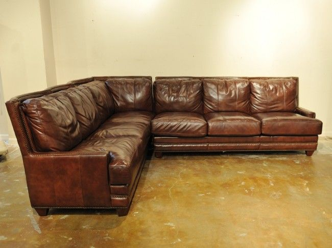 86 A Leather Sectional Sofa With
