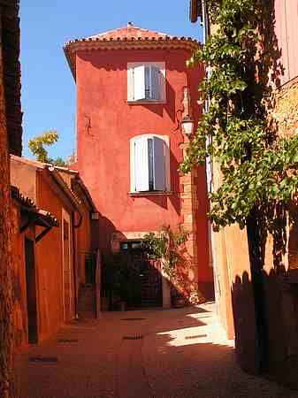 Roussillon a hilltop town in Provence,France.  I love the color of this house with the white shutters,  it's a beautiful contrast.