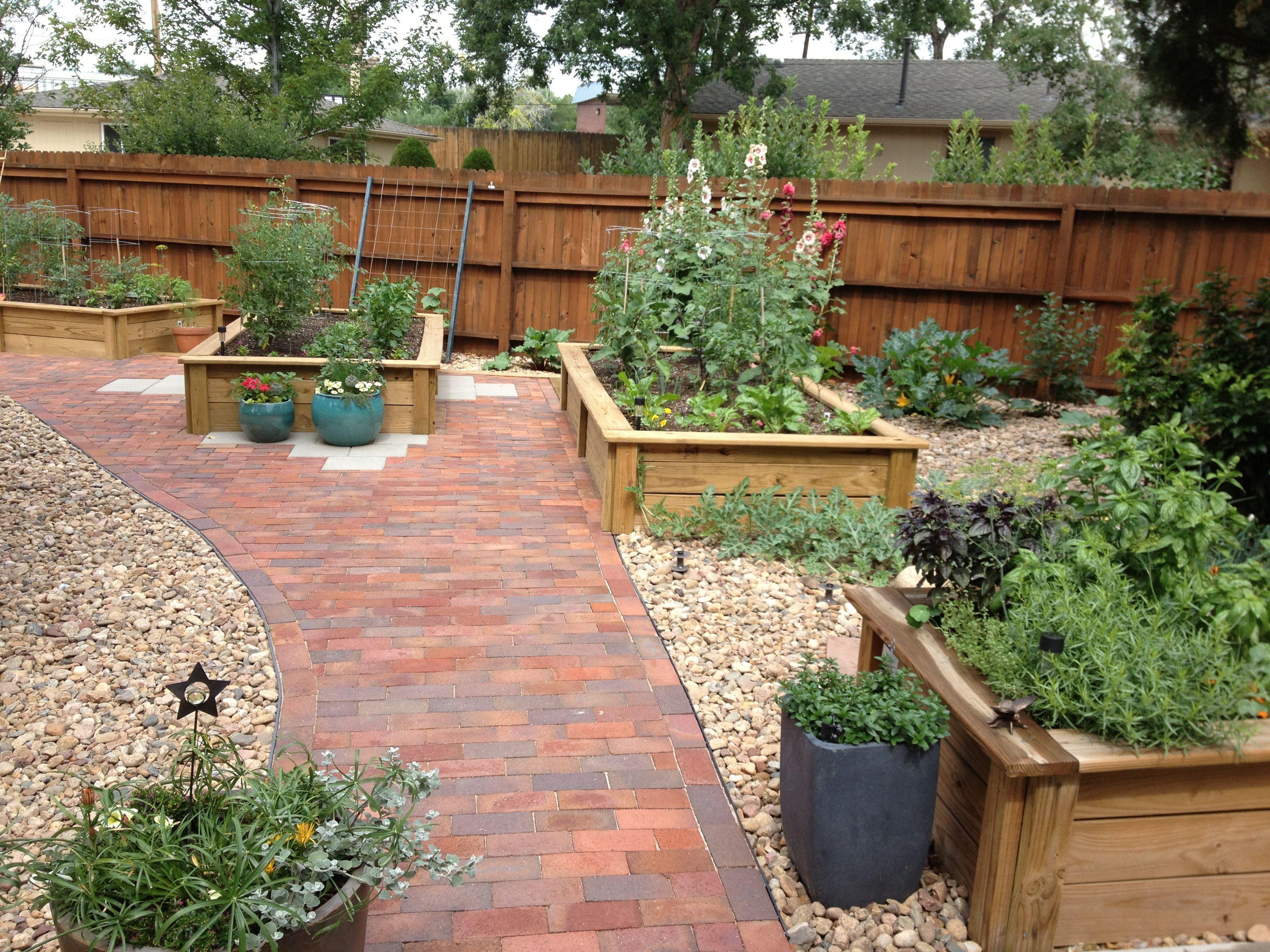 Raised beds with brick patiofar view Outdoor garden