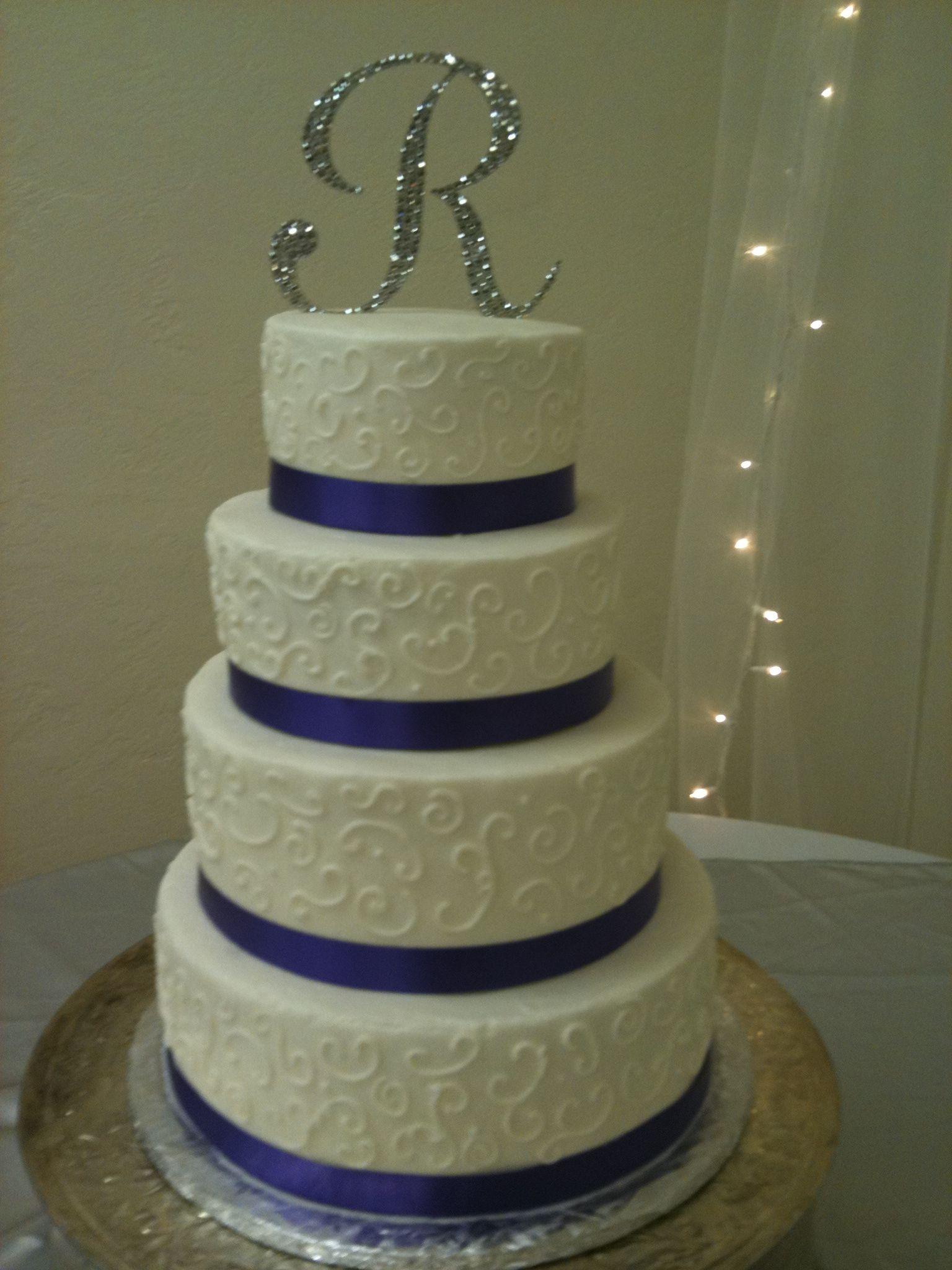 Purple and cream tiered wedding cake