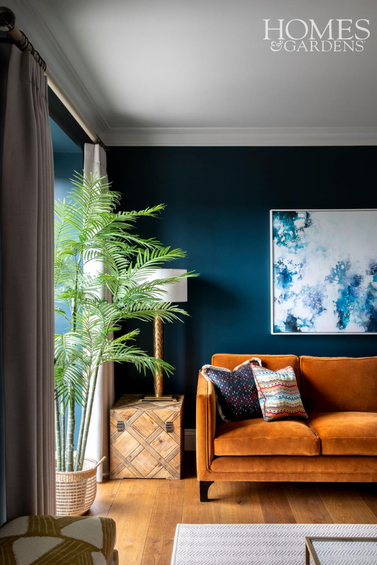 Urban Chic Living Room With Bold Pops Of Complimentary Colours Orange And Blue Living Room Green Living Room Color Living Room Orange