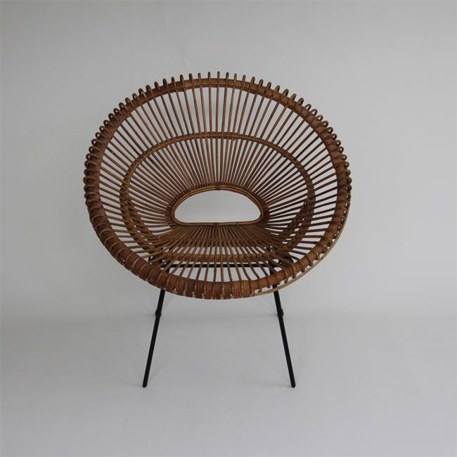 Sculptural modern rattan Franco Albini scoop chair with iron legs. Italian, circa 1950's.
