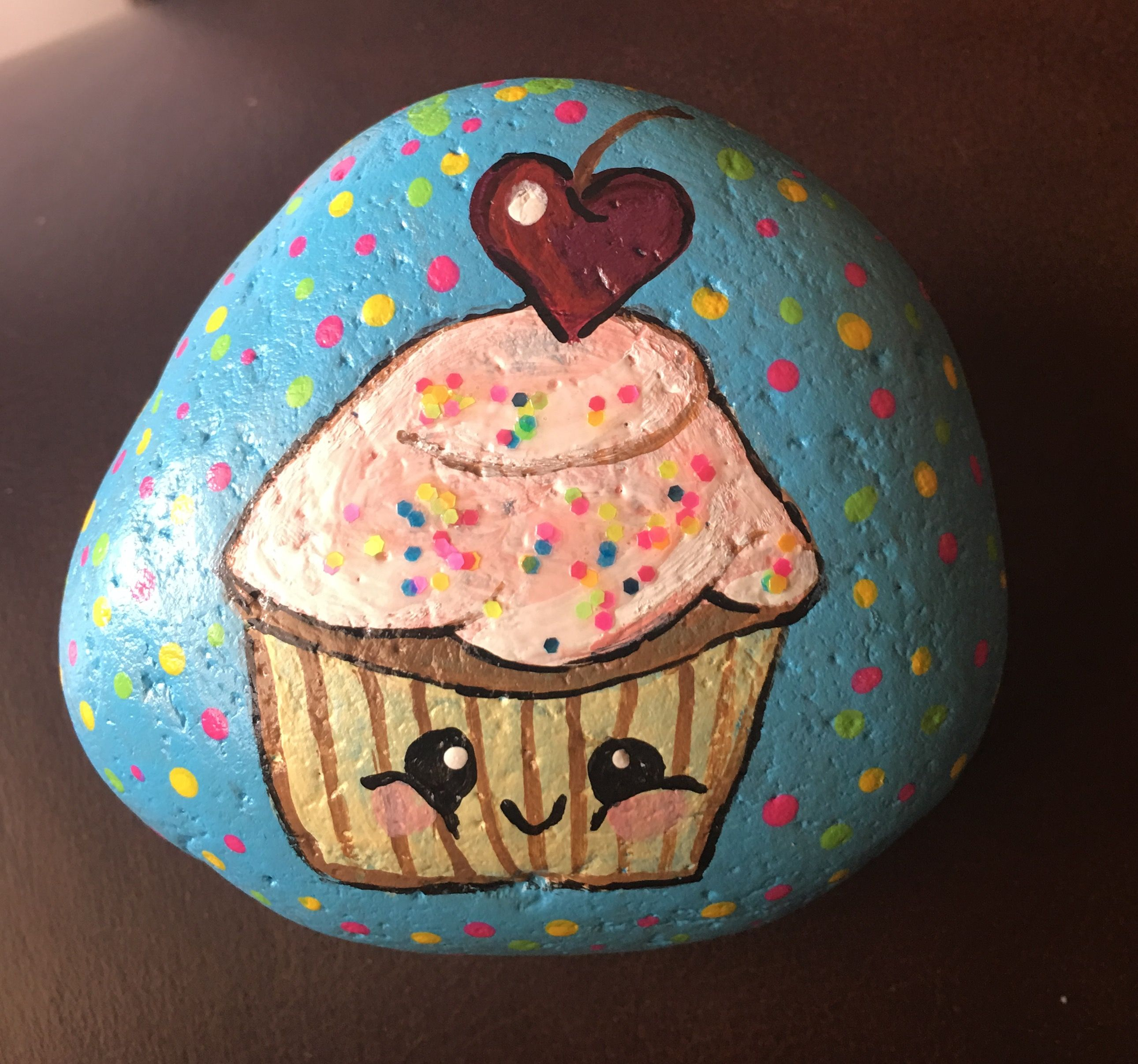 Cupcake painted rock the sprinkles on her frosting is