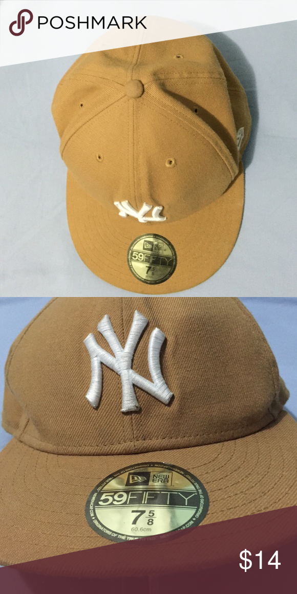 Rarely worn genuine New Era 59fifty NY SnapBack Perfect condition caramel colored white lettering NY 59fifty SnapBack with original sticker. All products are bundle-able New Era Accessories Hats